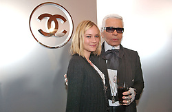 German born actress Diane Kruger and German fashion designer Karl Lagerfeld pictured during the backsatge of the Chanel Ready-to-Wear Fall-Winter 2005-2006 collection in Paris-France on March 4, 2005. Photo by Klein-Hounsfield/ABACA.