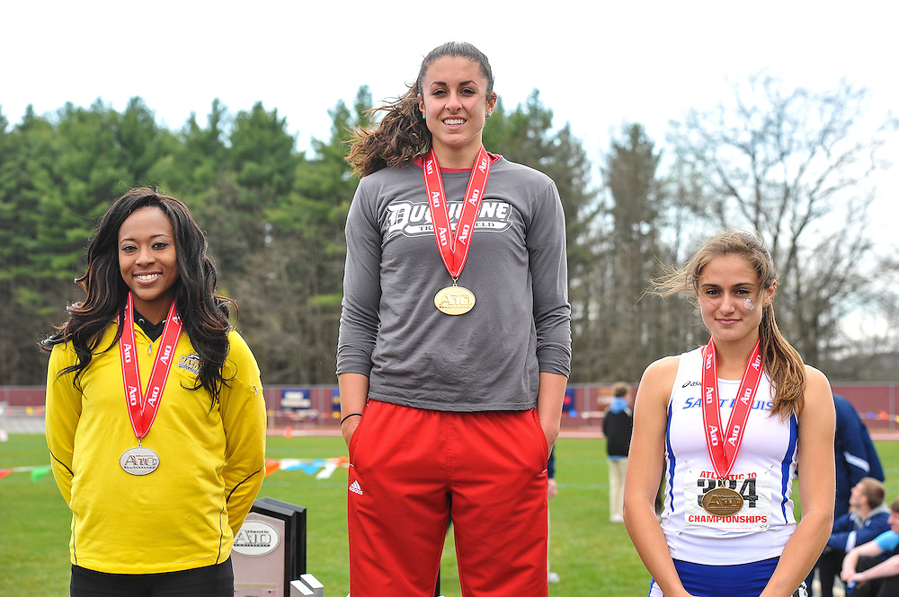 AMHERST, MA - MAY 4: Anna Simone of Duquesne University stands atop the podium after winning the women's 400 meter hurdles on Day 2 of the Atlantic 10 Outdoor Track and Field Championships at the University of Massachusetts Amherst Track and Field Complex on May 4, 2014 in Amherst, Massachusetts. Taylor Wheaton of George Mason University, left, finished second and Kita Alvares of St. Louis University finished third. (Photo by Daniel Petty/Atlantic 10)