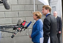 Angela Merkel, Germany's chancellor, makes a statement to the press as she arrives at the European People's Party meeting, in Brussels, Belgium, on March 25, 2010.  (Photo © Jock Fistick)