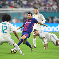 (R-L)  Lionel Messi of Barcelona takes on Marcelo of Real Madrid during the International Champions Cup match between Barcelona and Real Madrid at Hard Rock Stadium on July 29, 2017 in Miami Gardens, Florida. (Photo by Dave Winter/Icon Sport)