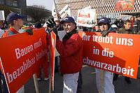 07 NOV 2002, BERLIN/GERMANY:<br /> Demonstraten mit Schildern, Demonstration gegen die Kuerzung der Eigenheimzulage, am Startpunkt Alexanderplatz<br /> IMAGE: 20021107-01-022<br /> KEYWORDS: Demo, Bau, Baugewerbe, Kürzung, Demostrant, demonstrator, Subventionen