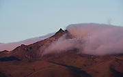 Sunset illuminates Sincholagua volcano high up in the Andes mountains of Ecuador.