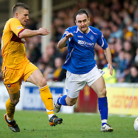 Motherwell v St Johnstone...28.01.12  <br /> Lee Croft tracked by Shaun Hutchinson<br /> Picture by Graeme Hart.<br /> Copyright Perthshire Picture Agency<br /> Tel: 01738 623350  Mobile: 07990 594431