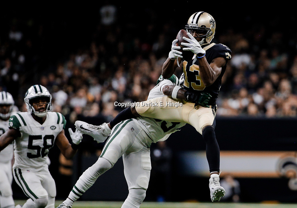 Dec 17, 2017; New Orleans, LA, USA; New Orleans Saints wide receiver Michael Thomas (13) catches a pass over New York Jets strong safety Jamal Adams (33) during the second half at the Mercedes-Benz Superdome. The Saints defeated the Jets 31-19. Mandatory Credit: Derick E. Hingle-USA TODAY Sports