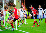 Port Vale's Ben Purkiss and Exeter City's Jordan Moore-Taylor in a goal mouth scramble during the The FA Cup match between Exeter City and Port Vale at St James' Park, Exeter, England on 6 December 2015. Photo by Graham Hunt.