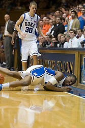 Duke guard Nolan Smith (2) reacts after colliding with the scorers table.  The Duke Blue Devils defeated the Virginia Cavaliers 87-65 in men's basketball at Cameron Indoor Stadium on the campus of Duke University in Durham, NC on January 13, 2008.