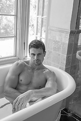 hot man sitting in a bathtub