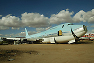 "Marana, Arizona, 12/9/03  The last stop.  A Boeing 747 sits in the reclamation section of the Evergreen Air Center. The once proud plane awaits ""the crusher"" where the aluminum will be salvaged and recyled for items like beer cans.  Photo by Dennis Brack"