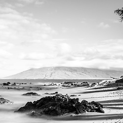 Mōkapu Beach black and white panorama photo in Wailea Makena Maui Hawaii with lava rocks and the Pacific Ocean. Copyright ⓒ 2019 Paul Velgos with All Rights Reserved.