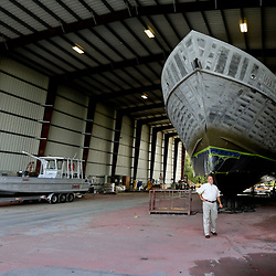Craig Romero director of the Port of Iberia, stands by a oil supply vessel being built at Breaux Brothers Enterprises Inc in Loreauville, Louisiana, U.S., on Friday, August 19, 2016.  Photographer: Derick E. Hingle/Bloomberg