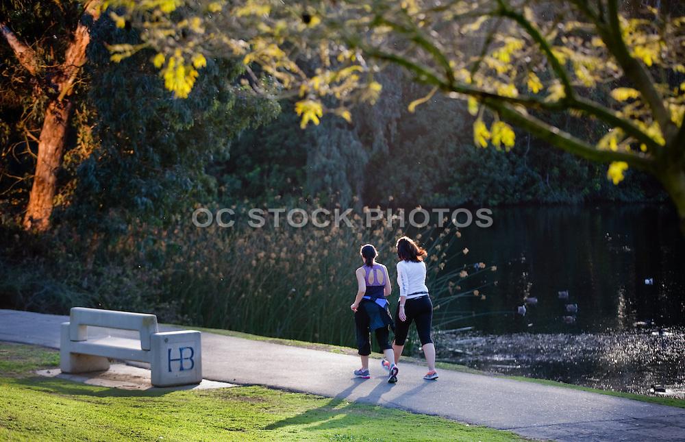 Women Running on Trail in Central Park Huntington Beach