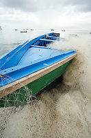 PANAMA, PANAMA - NOVEMBER 08: A small fishing boat lays at the end of the Muelle Fiscal in the  Panama City bay. November 08, 2009.  Panama, Panama. (Photo: Ruben Alfu / Istmophoto)