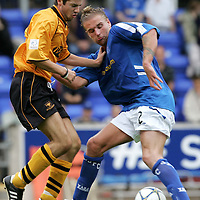 St Johnstone v Alloa Athletic..30.07.05  Bell's Cup<br />Ryan Stevenson is tackled by Darran Thomson.<br /><br />Picture by Graeme Hart.<br />Copyright Perthshire Picture Agency<br />Tel: 01738 623350  Mobile: 07990 594431