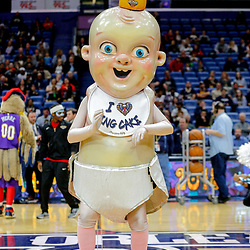 Feb 7, 2018; New Orleans, LA, USA; New Orleans mascot King Cake Baby performs for the crowd during a delay of a game between the New Orleans Pelicans and the Indiana Pacers that was postponed after a nearly two hour delay due to a roof leak at the Smoothie King Center. Mandatory Credit: Derick E. Hingle-USA TODAY Sports