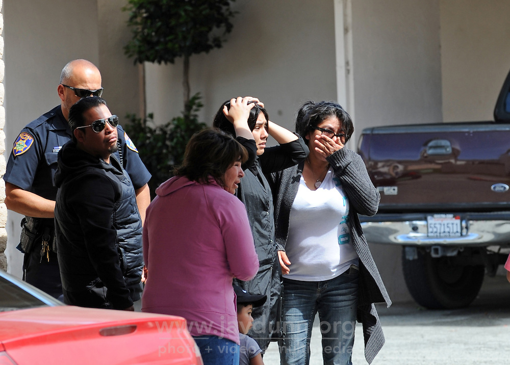 Distraught loved ones at the scene of Wednesday's fatal shooting at 912 Acosta Plaza in Salinas.
