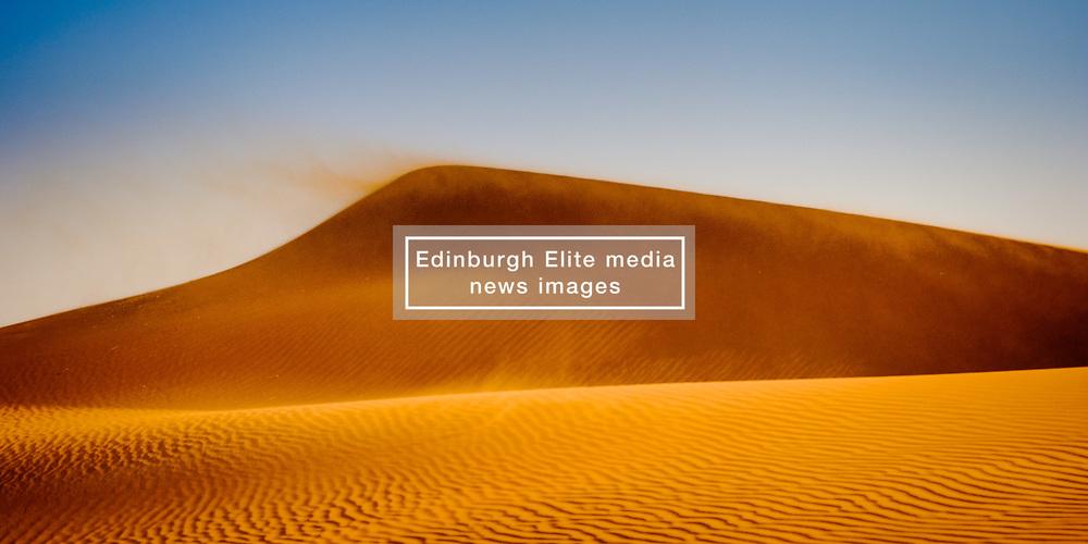 Sand blowing off the dunes in the Morroccan Sahara desert<br /> <br /> (c) Andrew Wilson | Edinburgh Elite media