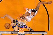 Dec 15, 2013; Phoenix, AZ, USA; Golden State Warriors forward David Lee (10) lays up the ball against the Phoenix Suns forward Channing Frye (8) in the first half at US Airways Center. The Suns defeated the Warriors 106-102. Mandatory Credit: Jennifer Stewart-USA TODAY Sports