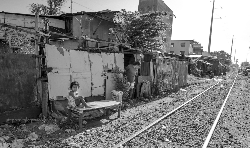 Life along the tracks by the gypsies and displaced people of Binan City. People just hanging around the track with little else to do