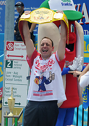 Joey Chestnut holds his championship belt and smiles after winning men's competition of the Nathan's Hot Dog Eating Contest at Coney Island of New York City, NY, USA, on July 4, 2018. Joey Chestnut set a new world record Wednesday by devouring 74 hot dogs in 10 minutes at the Nathan's Hot Dog Eating Contest in New York. Miki Sudo defended the women's title by eating 37 hot dogs in 10 minutes. Photo by Dennis Van Tine/ABACAPRESS.COM