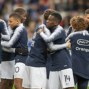 PARIS, FRANCE - March 25:  French players hug after warming up before the France V Iceland, 2020 European Championship Qualifying, Group Stage at  Stade de France on March 25th 2019 in Paris, France (Photo by Tim Clayton/Corbis via Getty Images)