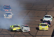 Nov. 14, 2009; Avondale, AZ, USA; NASCAR Nationwide Series driver  Paul Menard (98) and Jason Bowles (61) crash during the Able Body Labor 200 at Phoenix International Raceway. Mandatory Credit: Jennifer Stewart-US PRESSWIRE
