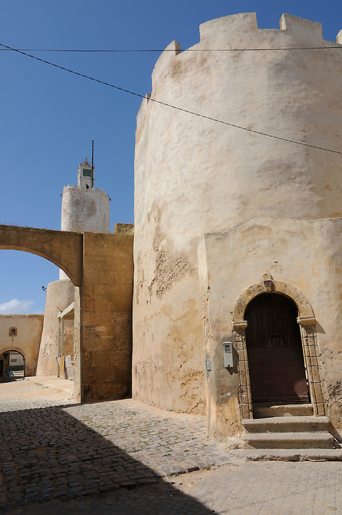 An old-fashioned building with a big, round tower.  El Jadida. Morocco. Africa.