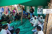 Manga and Sheela meet a group of local farmers to learn about making organic fertiliser for their farms at a farmer field school, Sendhwa, India.