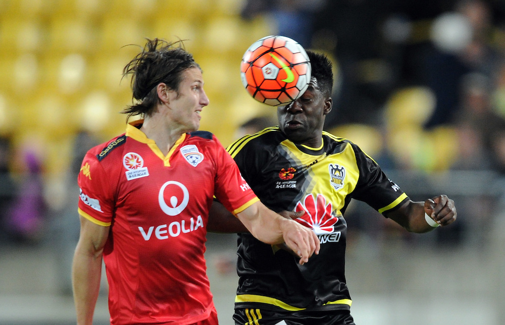 Adelaide United's Michael Marrone, left, contests the ball with Phoenix's Rolieny Bonevacia in the A-League football match at Westpac Stadium, Wellington, New Zealand, Friday, November 13, 2015. Credit:SNPA / Ross Setford