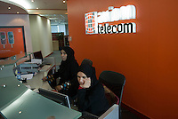 Women at the reception of Axiom Telecom wear the tradional black abaya. Dubai, one of the seven emirates and the most populous of the United Arab Emirates sits on the southern coast of the Persian gulf.