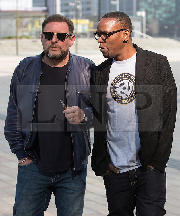 © Licensed to London News Pictures . 19/03/2015 . Salford Quays , UK . Shaun Ryder with an e-cigarette and Paul Leveridge . Black Grape photocall at The Green , Salford Quays , Greater Manchester . Black Grape are reforming for a Madchester charity gig along with other local bands , to raise awareness for Bez's Reality Party and anti-fracking . Photo credit : Joel Goodman/LNP