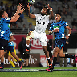 Lukhanyo Am leaps for a high ball under pressure from Blues fullback Michael Collins (left) during the Super Rugby match between the Blues and Sharks at Eden Park in Auckland, New Zealand on Saturday, 31 March 2018. Photo: Dave Lintott / lintottphoto.co.nz