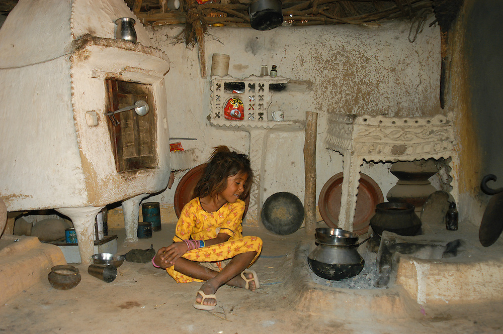 Traditional kitchen in village mud huts, Jaisalmer, Rajasthan, India.