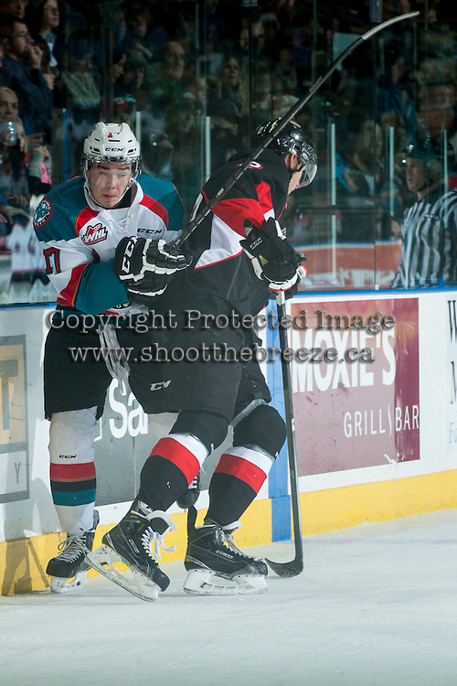 KELOWNA, CANADA - DECEMBER 30: Sam Ruopp #2 of Prince George Cougars checks Rodney Southam #17 of Kelowna Rockets into the boards on December 30, 2014 at Prospera Place in Kelowna, British Columbia, Canada.  (Photo by Marissa Baecker/Shoot the Breeze)  *** Local Caption *** Rodney Southam; Sam Ruopp;