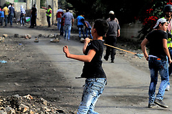 November 11, 2016 - Nablus, West Bank, Palestine - A Palestinian protester hurls stones at Israeli soldiers during clashes near the West Bank town of Nablus on Nov. 11, 2016. (Credit Image: © Moahmmed Turabi/ImagesLive via ZUMA Wire)