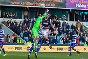 Reading goalkeeper Rafael Cabral Barbosa (33) and Millwall forward Mathieu Smith (10) clash in the air during the EFL Sky Bet Championship match between Millwall and Reading at The Den, London, England on 18 January 2020.