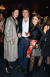 Left to right, the HON.FLORA STOR, MR JAN PASTORI and MISS FRANCESCA VERSACE at a party hosted by Panerai and the Baglioni Hotel, 60 Hyde Park Gate, London on 6th December 2004.<br /><br />NON EXCLUSIVE - WORLD RIGHTS