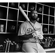 Howie Kendrick, Los Angeles Dodgers, in the dugout preparing to bat during the New York Mets Vs Los Angeles Dodgers MLB regular season baseball game at Citi Field, Queens, New York. USA. 25th July 2015. Photo Tim Clayton