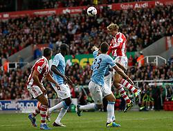 Stoke City's Peter Crouch wins an aerial ball - Photo mandatory by-line: Matt Bunn/JMP - Tel: Mobile: 07966 386802 14/09/2013 - SPORT - FOOTBALL -  Britannia Stadium - Stoke-On-Trent - Stoke City V Manchester City - Barclays Premier League