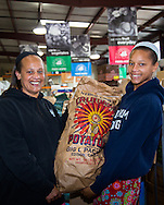 Mother-and-daughter team selecting produce for their agency to distribute to the community