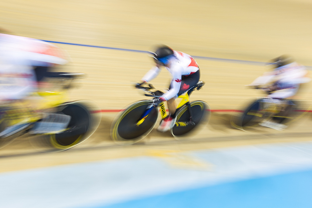The Canadian team competes in the women's team pursuit qualification on the fist day of track cycling at the 2015 Pan American Games in Toronto, Canada, July 16,  2015.  AFP PHOTO/GEOFF ROBINS