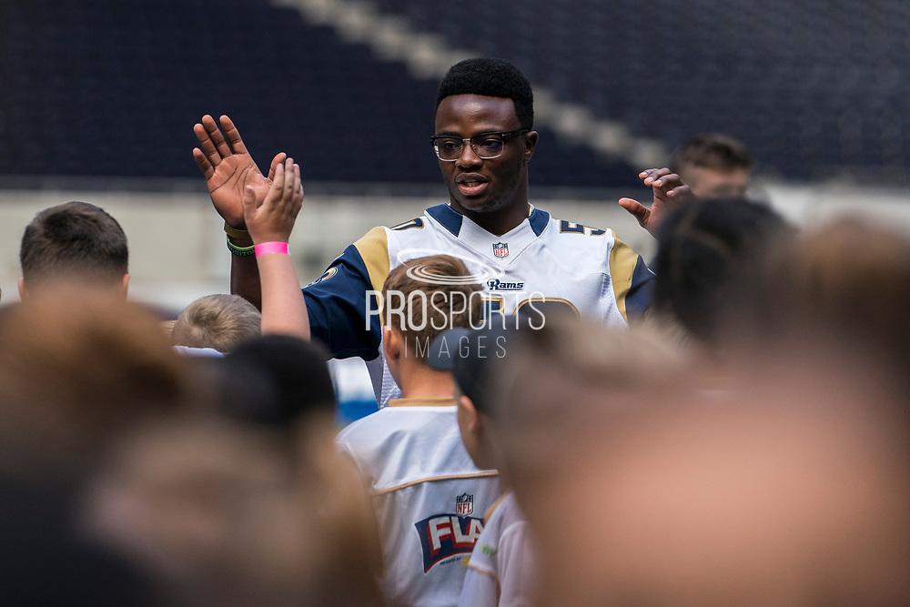 Samson Ebukam (LB, LA Rams) greets the kids ahead of todays NFL Flag National Championship Finals during the NFL UK Media Day at Tottenham Hotspur Stadium, London, United Kingdom on 3 July 2019.