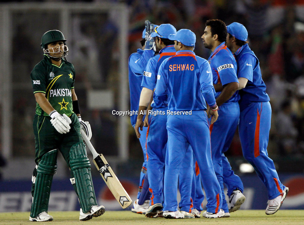 30.03.2011 Cricket World Cup from the Punjab Cricket Association Stadium, Mohali in Chandigarh. India v Pakistan. Kamran Akmal of Pakistan walks back after getting out during the match of the ICC Cricket World Cup between India and Pakistan on the 30th March 2011