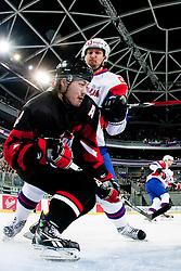 Ales Kranjc of Slovenia hits Go Tanaka of Japan during ice-hockey match between Slovenia and Japan at IIHF World Championship DIV. I Group A Slovenia 2012, on April 16, 2012 at SRC Stozice, Ljubljana, Slovenia. (Photo By Matic Klansek Velej / Sportida.com)