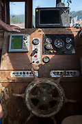 The steering wheel and controls of a British trawler fishing boat, Kent, United Kingdom. (photo by Andrew Aitchison / In pictures via Getty Images)