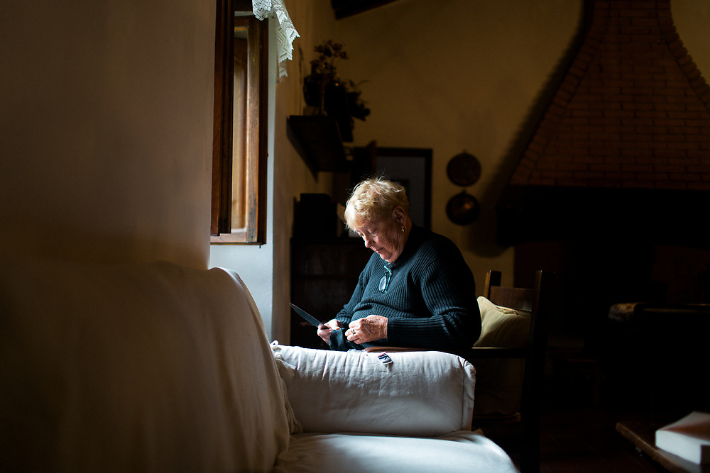Mature Woman indoors, Tuscany Italy.