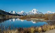 Mt Moran (12,605 feet) reflects in the Snake River at Oxbow Bend, in Grand Teton National Park, Wyoming, USA. <br /> The mountain is named for&nbsp;Thomas Moran, an American western frontier landscape artist. Mount Moran dominates the northern section of the&nbsp;Teton Range&nbsp;rising 6000 feet above&nbsp;Jackson Lake.&nbsp;Several active glaciers exist on the mountain with&nbsp;Skillet Glacier&nbsp;plainly visible on the monolithic east face. This image was stitched from multiple overlapping photos.