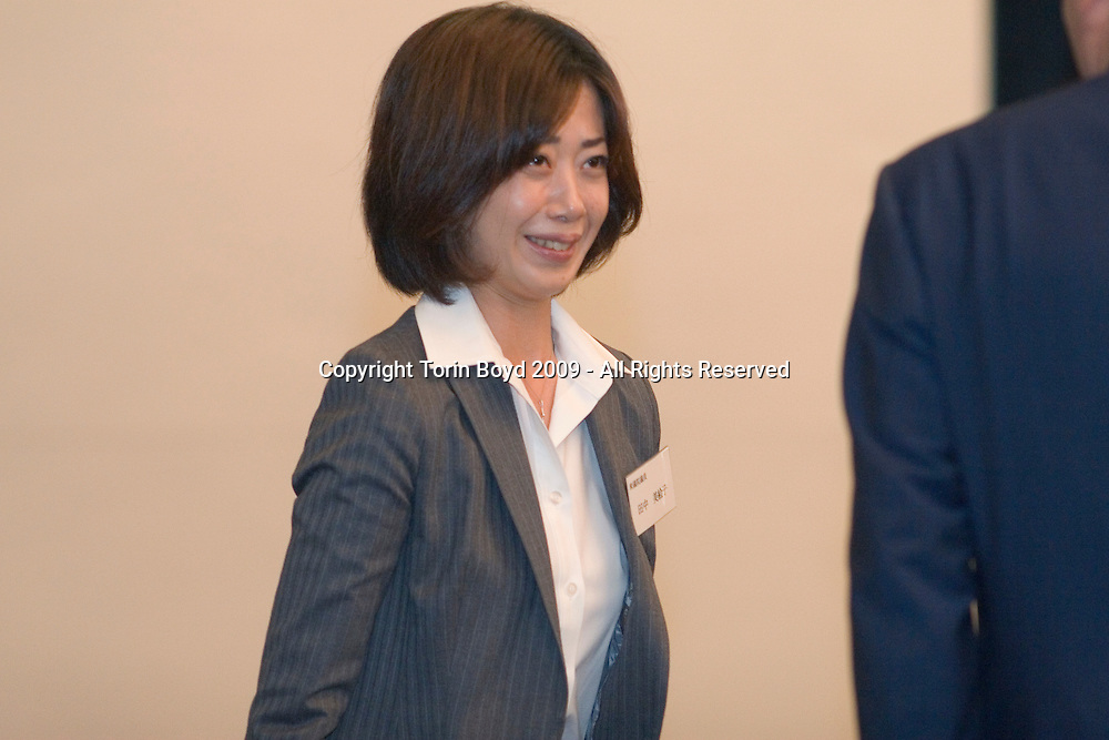 """This is Mieko Tanaka, a newly elected parliamentarian to Japan's House of Representatives and member of the Democratic Party of Japan (DPJ). This 33 year old beauty from Ishikawa Prefecture has been drawing attention in both political and the media circles due to her quick rise in politics and nearly beating former Prime Minister Yoshiro Mori by 4000  votes in the recent nationwide elections. She won a seat in parliament due to her party's proportional representation quota. When the former PM learnt of the results, he commented that she won due to her sexiness. Miss Tanaka who's a former travel agent and writer who used to report on the Japan's sex industry sometimes dressed in S&M costumes is a protégé of Ichiro Ozawa, the kingpin of the DPJ. Ozawa recruited a group of young women to run in the recent nationwide election who came to be dubbed as """"Ozawa's Girls"""" and """"Princess Brigade"""". Miss Tanaka herself campaigned in her constituency on a bicycle dressed in DPJ pink. A record 54 women won parliamentary seats in the Aug. 30 election, a milestone for female representation in Japanese government."""