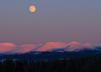 Moonrise over mountains near Whitehorse, Yukon