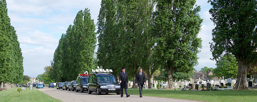 Leslie Rhodes funeral at North East Surrey Crematorium, Morden, Surrey, Great Britain 5th May 2017 <br /> <br /> The Cortage on it's way to the crematorium <br /> <br /> Leslie Rhodes was one of the victims of the Westminster terror attack on 22nd March 2017. Mr Rhodes was Winston Churchill's former window cleaner.<br /> <br /> Leslie Rhodes, from south London, suffered serious injuries when terrorist Khalid Masood mowed down pedestrians on Westminster Bridge. The 75-year-old was rushed to King&rsquo;s College Hospital but died there when his life support was withdrawn at about 8.25pm the following day. <br /> <br /> He had been attending an appointment at St Thomas&rsquo;s Hospital before Masood went on a rampage &ndash; killing four and injuring 50 before he was shot dead by police.<br /> <br /> Mr Rhodes, who friends revealed was the former window cleaner of Winston Churchill, suffered broken ribs and a punctured lung in the attack.<br /> <br /> <br /> Photograph by Elliott Franks <br /> Image licensed to Elliott Franks Photography Services