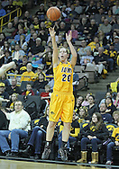 December 20, 2011: Iowa Hawkeyes forward Kelly Krei (20) puts up a shot during the NCAA women's basketball game between the Drake Bulldogs and the Iowa Hawkeyes at Carver-Hawkeye Arena in Iowa City, Iowa on Tuesday, December 20, 2011. Iowa defeated Drake 71-46.